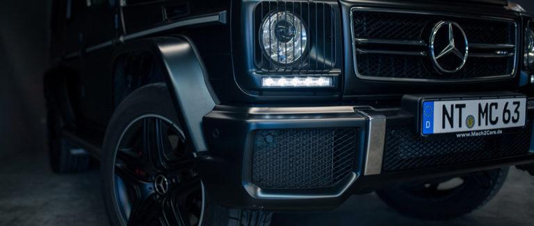 Mercedes G63 AMG in schwarz das Licht vorne rechts bei mach2cars in Stuttgart